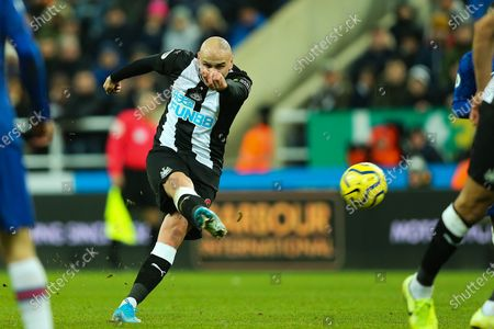Jonjo Shelvey (#8) of Newcastle United hits a shot from outside the penalty box during the Premier League match between Newcastle United and Chelsea at St. James's Park, Newcastle