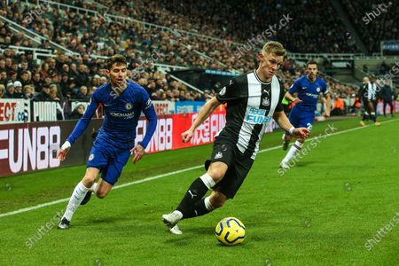 Emil Krafth (#17) of Newcastle United looks to cross the ball during the Premier League match between Newcastle United and Chelsea at St. James's Park, Newcastle