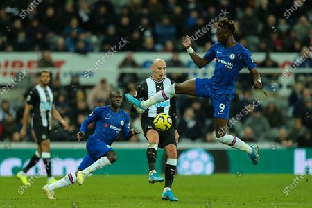 Stock Photo of Jonjo Shelvey (#8) of Newcastle United controls the ball as Tammy Abraham (#9) of Chelsea attempts to block during the Premier League match between Newcastle United and Chelsea at St. James's Park, Newcastle
