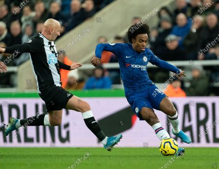 Stock Image of Willian of Chelsea tracked by Jonjo Shelvey of Newcastle