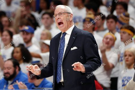 North Carolina head coach Roy Williams yells to his team as they play against Pittsburgh during the first half of an NCAA college basketball game, in Pittsburgh. Pittsburgh won 66-52
