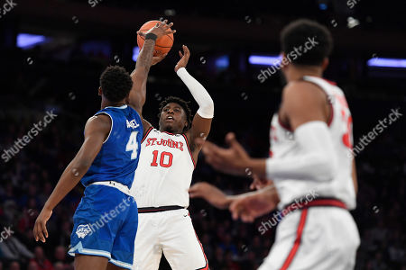 Stock Picture of St. John's forward Marcellus Earlington (10) shoots the ball as Seton Hall forward Tyrese Samuel (4) defends during the second half of an NCAA college basketball game in New York