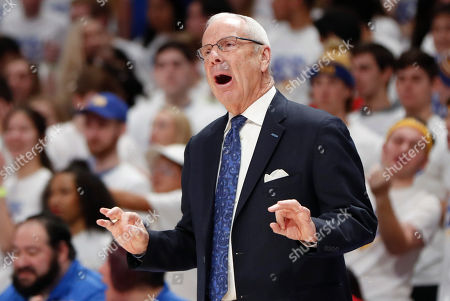 North Carolina head coach Roy Williams yells to his team as they play against Pittsburgh during the first half of an NCAA college basketball game, in Pittsburgh