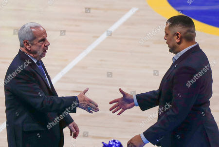 Pittsburgh head coach Jeff Capel, right, shakes hands with North Carolina head coach Roy Williams after an NCAA college basketball game, in Pittsburgh. Pittsburgh won 66-52