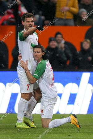 Stock Photo of of  Florian Niederlechner #7 (FC Augsburg) and Stephan Lichtsteiner #2 (FC Augsburg)  1:0, FC Augsburg vs. Borussia Dortmund, Football, 1.Bundesliga, 18.01.2020, DFL REGULATIONS PROHIBIT ANY USE OF PHOTOGRAPHS AS IMAGE SEQUENCES AND/OR QUASI-VIDEO