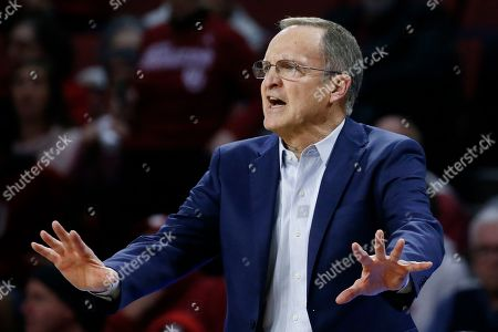 Oklahoma head coach Lon Kruger coaches from the sideline during the second half of an NCAA college basketball game against TCU in Norman, Okla