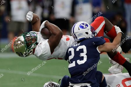 East running back Benny LeMay, of Charlotte, (32) scores against the West safety Austin Lee, of BYU, (23) during the first half of the East West Shrine football game, in St. Petersburg, Fla
