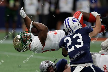Stock Image of East running back Benny LeMay, of Charlotte, (32) scores past West safety Austin Lee, of BYU, (23) during the first half of the East West Shrine football game, in St. Petersburg, Fla