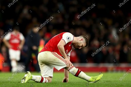 Shkodran Mustafi of Arsenal shows signs of an injury after the 1-1 draw