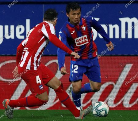 Eibar's Takashi Inui (R) in action against Atletico Madrid's Santiago Arias during a Spanish LaLiga soccer match between Eibar and Atletico Madrid at the Ipurua stadium in Eibar, Basque Country, northern Spain, 18 January 2020.
