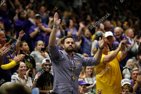 Stock Picture of Former LSU quarterback and national champion Matt Flynn acknowledges the crowd as he is introduced during a celebration of their NCAA college football championship, on the LSU campus in Baton Rouge, La