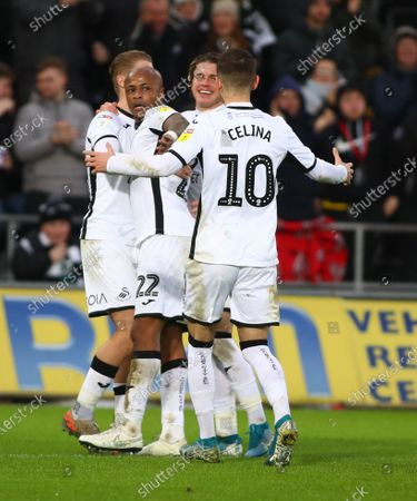 Swansea City players celebrate after Andre Ayew of Swansea City goal makes it 2-1 in the second half