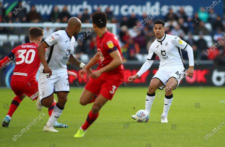 Ben Cabango of Swansea City plays the through ball to Andre Ayew of Swansea City