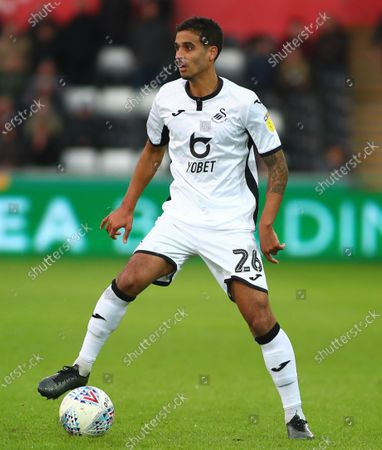 Kyle Naughton of Swansea City looks up for support