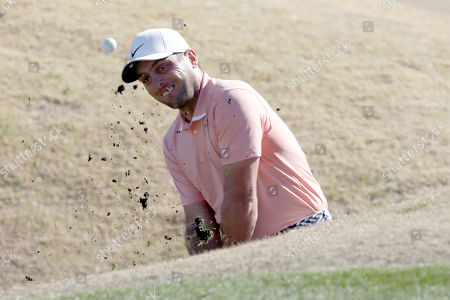 Francesco Molinari hits out of a bunker on the third hole during the third round of The American Express golf tournament on the Stadium Course at PGA West in La Quinta, Calif