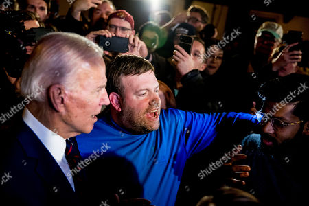 Joe Biden, Frank Luntz. Political consultant Frank Luntz, center, speaks with Democratic presidential candidate former Vice President Joe Biden, left, as he greets members of the audience at a campaign stop at Simpson College, in Indianola, Iowa
