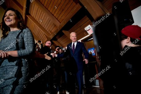 Rep. Abby Finkenauer, D-Iowa, left, and Democratic presidential candidate former Vice President Joe Biden, arrive at a campaign stop at Simpson College, in Indianola, Iowa