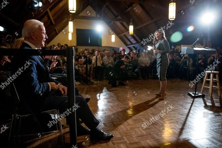 Rep. Abby Finkenauer, D-Iowa, right, speaks before welcoming Democratic presidential candidate former Vice President Joe Biden to the floor during a campaign stop at Simpson College, in Indianola, Iowa