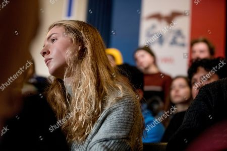 A member of the audience listens as Democratic presidential candidate former Vice President Joe Biden holds a campaign stop at Simpson College, in Indianola, Iowa
