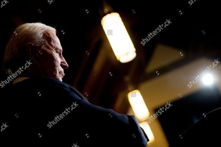 Democratic presidential candidate former Vice President Joe Biden waits to be called up to speak at a campaign stop at Simpson College, in Indianola, Iowa