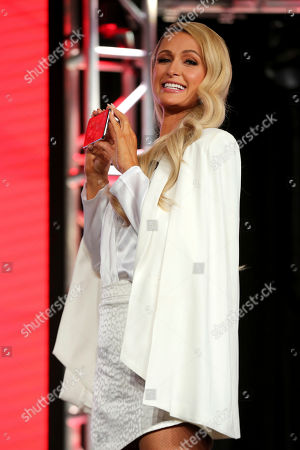 Paris Hilton holds her phone as she assists illusionist David Blaine during the YouTube TCA 2020 Winter Press Tour at the Langham Huntington, in Pasadena, Calif