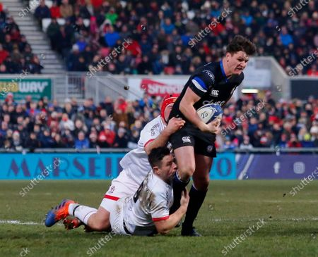 Stock Picture of Freddie Burns of Bath is tackled by Eric O'Sullivan and John Cooney of Ulster
