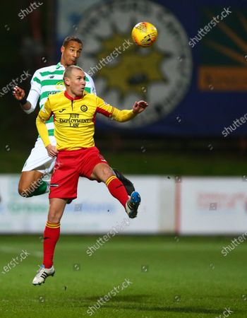 Christopher Jullien of Celtic beats Kenny Miller of Partick Thistle in the air