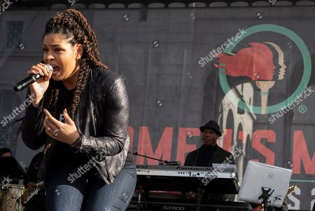 Singer Jordin Sparks performs at the 4th Women's March in Los Angeles on . Thousands gathered in cities across the country Saturday as part of the nationwide Women's March rallies focused on issues such as climate change, pay equity, reproductive rights and immigration