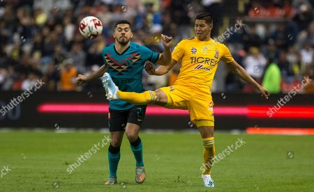 Stock Image of CP. Tigres' Hugo Ayala, right, fights for the ball with America's Josue Martin during a Mexico soccer league match at Azteca Stadium in Mexico City