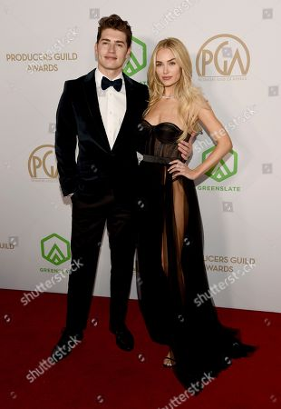 Gregg Sulkin, Michelle Randolph. Gregg Sulkin, left, and Michelle Randolph arrive at the 2020 Producers Guild Awards at the Hollywood Palladium, in Los Angeles, Calif