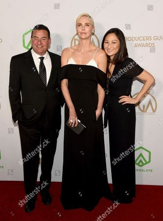 Stock Image of A.J. Dix, Charlize Theron, Beth Kono. A.J. Dix, from left, Charlize Theron and Beth Kono arrive at the 2020 Producers Guild Awards at the Hollywood Palladium, in Los Angeles, Calif