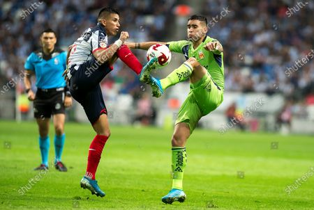Monterrey's midfielder Maximiliano Meza (L) in action against Morelia's defender Sebastian Vegas (R) during a day two match of the Clausura 2020 Tournament played at the BBVA Stadium in Monterrey, Mexico, 18 January 2020.