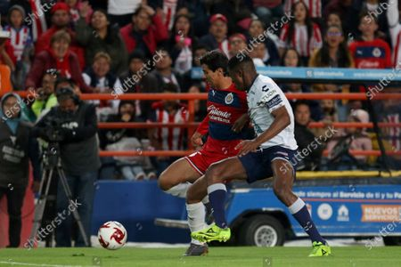 Pachuca's defender Oscar Murillo (R) in action against Chivas Rayadas' forward Jose Macias (L) during a day two macth in the Clausura 2020 Tournament, held at the Hidalgo Stadium in Pachuca, Mexico, 18 January 2020.