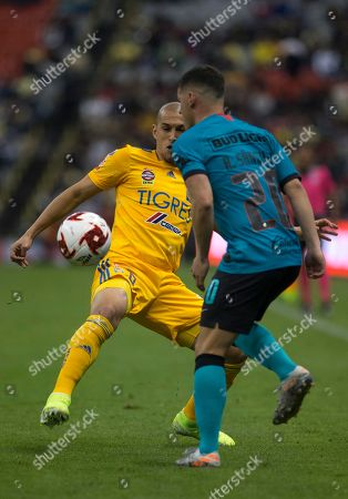 Stock Image of CP. Tigres' Jorge Torres, left, fights for the ball with America's Rafael Sanchez during a Mexico soccer league match at Azteca Stadium in Mexico City, Saturday, Jan.18, 2020