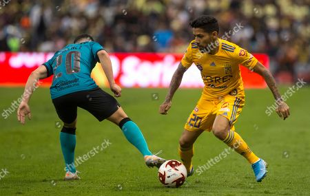 CP. Tigres' Javier Aquino, right, fights for the ball with Americas' Rafael Sanchez during a Mexico soccer league match at Azteca Stadium in Mexico City, Saturday, Jan.18, 2020