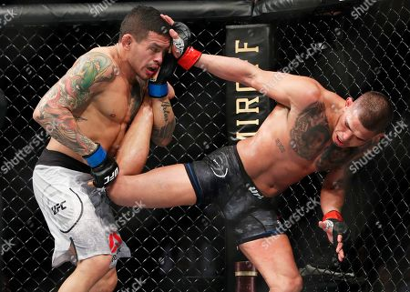 Stock Picture of Anthony Pettis, right, fights Diego Ferreira during a UFC 246 lightweight mixed martial arts bout, in Las Vegas
