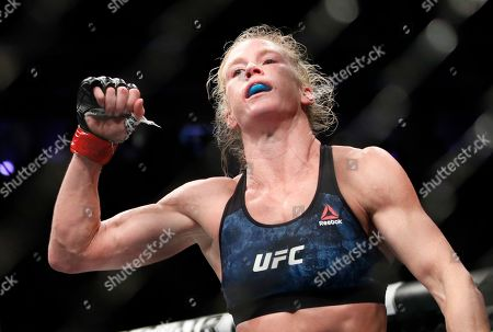 Stock Image of Holly Holm celebrates after defeating Raquel Pennington during a UFC 246 women's bantamweight mixed martial arts bout, in Las Vegas