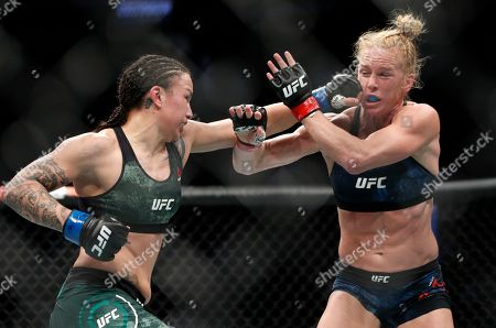 Stock Picture of Raquel Pennington, left, hits Holly Holm during a UFC 246 women's bantamweight mixed martial arts bout, in Las Vegas