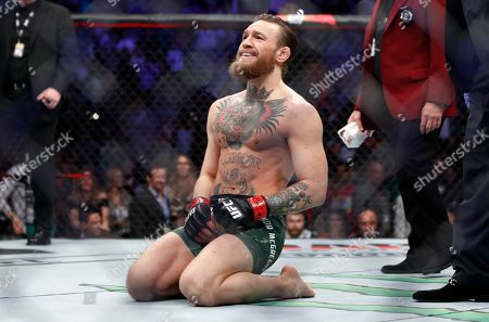 """Conor McGregor smiles after defeating Donald """"Cowboy"""" Cerrone during a UFC 246 welterweight mixed martial arts bout, in Las Vegas"""