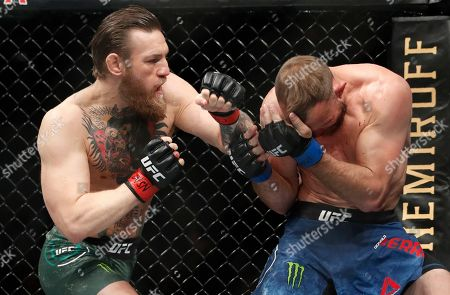 """Conor McGregor, left, fights Donald """"Cowboy"""" Cerrone during a UFC 246 welterweight mixed martial arts bout, in Las Vegas"""