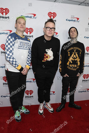 Matt Skiba, Mark Hoppus, Travis Barker. Matt Skiba,on left, Mark Hoppus and Travis Barker of Blink 182 attend the 2020 iHeartRadio ALTer Ego concert at the Forum on in Inglewood. Calif
