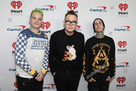 Matt Skiba, Mark Hoppus, Travis Barker. Matt Skiba, left, Mark Hoppus and Travis Barker of Blink 182 attend the 2020 iHeartRadio ALTer Ego concert at the Forum on in Inglewood. Calif