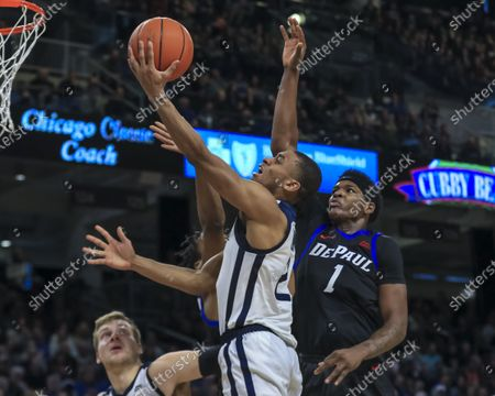 Saturday  - Butler Bulldogs guard Aaron Thompson (2) puts up a shot contested by DePaul Blue Demons forward Romeo Weems (1) during the NCAA game between the Butler Bulldogs and the DePaul University Blue Demons at Wintrust Arena in Chicago IL. Gary E