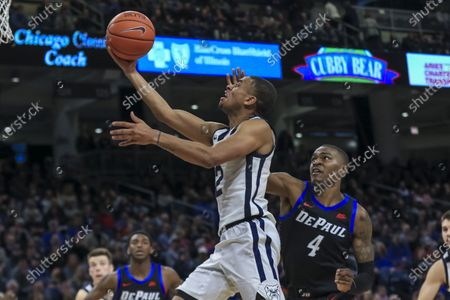 Stock Image of Saturday  - Butler Bulldogs guard Aaron Thompson (2) drives past the defense of DePaul Blue Demons forward Paul Reed (4) on the way to the basket during the NCAA game between the Butler Bulldogs and the DePaul University Blue Demons at Wintrust Arena in Chicago IL. Gary E