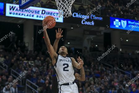 Stock Photo of Saturday  - Butler Bulldogs guard Aaron Thompson (2) puts up a shot during the NCAA game between the Butler Bulldogs and the DePaul University Blue Demons at Wintrust Arena in Chicago IL. Gary E