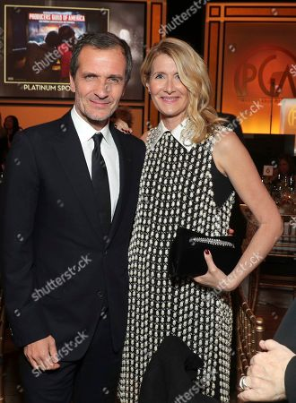 David Heyman, Laura Dern. David Heyman, left, and Laura Dern attend the 31st Annual Producers Guild Awards at the Hollywood Palladium, in Los Angeles
