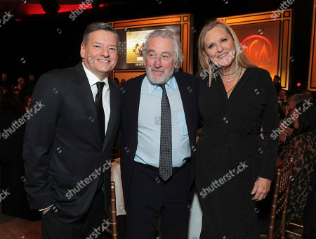 Ted Sarandos, Robert De Niro, Lori McCreary. Ted Sarandos, from left, Robert De Niro, and Lori McCreary attend the 31st Annual Producers Guild Awards at the Hollywood Palladium, in Los Angeles