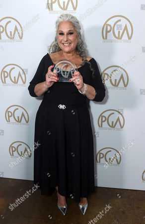 Marta Kauffman, winner of the Norman Lear Achievement Award, attends the 31st Annual Producers Guild Awards at the Hollywood Palladium, in Los Angeles