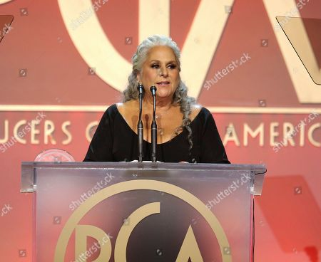 Marta Kauffman accepts the Norman Lear Achievement Award at the 31st Annual Producers Guild Awards at the Hollywood Palladium, in Los Angeles