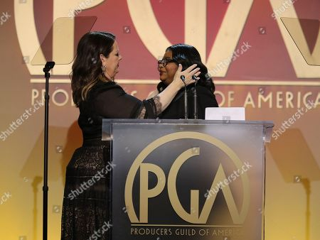Melissa McCarthy, Octavia Spencer. Melissa McCarthy, left, presents Octavia Spencer with the Visionary Award at the 31st Annual Producers Guild Awards at the Hollywood Palladium, in Los Angeles
